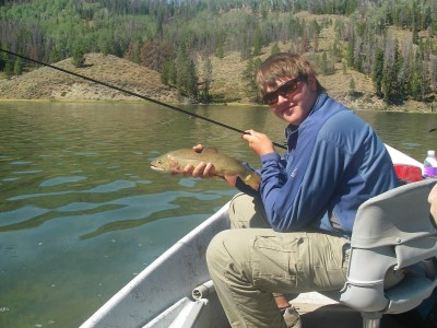 Hunter with Cutthroat Trout