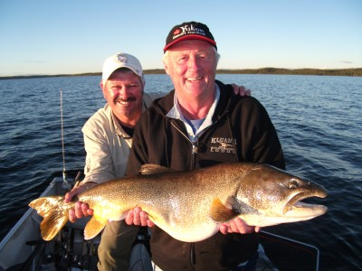 Chris Tarrant and John holding CT's 40lb Laker